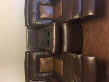 Brown leather recliner couch with cup holder in Fort Carson, Colorado