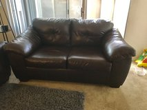Leather loveseat + dark grey couch cover in Travis AFB, California