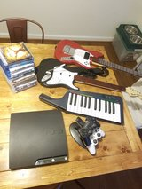 PS3, rock band set, controllers, charging station, games and Blu rays in Quantico, Virginia