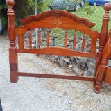 Queen size brown wooden bed headboard/footboard in Clarksville, Tennessee