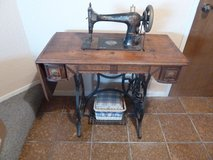 ANTIQUE SINGER TREADLE SEWING MACHINE AND CABINET in Oceanside, California