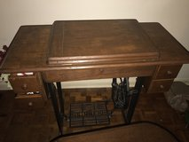 Old singer sewing table with chair in Fort Polk, Louisiana