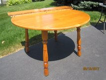 Round wooden table w/ 2 leaves in Naperville, Illinois
