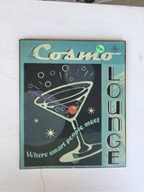 "light blue metal sign reads ""Cosmic Lounge - where smart people meet"" in Travis AFB, California"