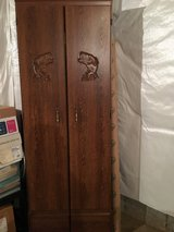 Wood fishing cabinet for storage and display in Batavia, Illinois