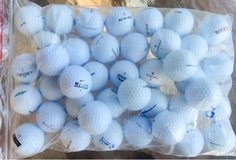 100 assorted various brand name golf balls near mint condition in Oswego, Illinois
