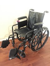 Wheelchair with leg raiser attachments and foot rests in Kingwood, Texas
