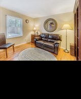 Leather reclinable sofa, mirror, LL Bean rug, Leather office chair, side table, lamps, bookshelf in Naperville, Illinois