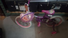 "12"" disney girl bike with helmet in 29 Palms, California"
