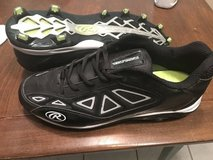 Size 14 Rawlings football shoes in Kingwood, Texas