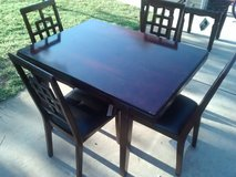 Ashley Furniture Dining Table and (4) Chairs in Perry, Georgia