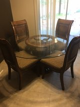 glass dinner room table with 4 chairs in 29 Palms, California