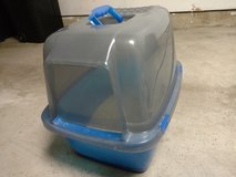 Cat litter box with flap door in Bartlett, Illinois