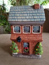 Ceramic Christmas house bank in Chicago, Illinois