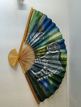 Fairly large Asian fan with white tigers painted on them in Travis AFB, California