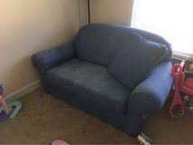 Blue couch with Pullout bed in Camp Lejeune, North Carolina