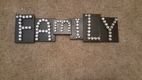 Metal family sign in Fort Polk, Louisiana