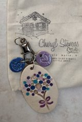 Clay necklace with charms, brand new with original bag in Westmont, Illinois