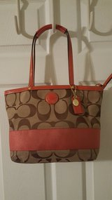 Coach Signature (orange) pre-owned in Pleasant View, Tennessee