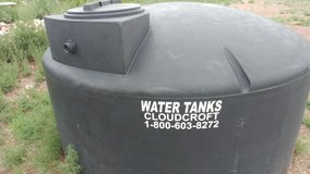 Black 800 gallon water tank in Alamogordo, New Mexico