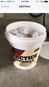 Bucket of Practice Softballs in Dover AFB, Delaware