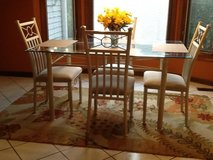 Glass Kitchen Table w/4 upholstered cream color chairs in Yorkville, Illinois