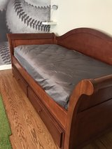 kids twin cherry wood stained day bed & trundle with (2) mattresses in Waukegan, Illinois