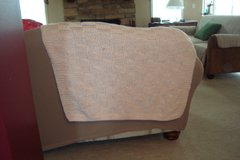 Peach color knitted baby blanket in DeKalb, Illinois