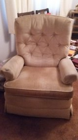 Gold swivel rocking chair in MacDill AFB, FL