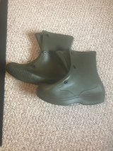 Green waterproof over boots in Fort Riley, Kansas