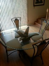 Glass dining room table with four chairs in Beaufort, South Carolina