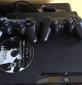 PS3 with controllers and games in Camp Lejeune, North Carolina