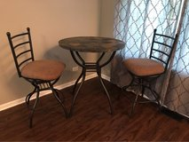 stone table with two bar stools in St. Charles, Illinois
