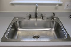 LIKE NEW Sterling deep bowl stainless steel sink with delta faucet in Wilmington, North Carolina