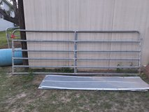 12' galvanized tube gate with fencing in Warner Robins, Georgia