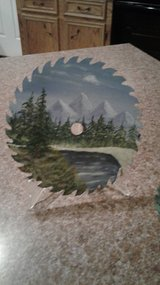 Hand painted saw blade in Fort Polk, Louisiana