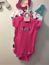 NEW WITH TAGS - Gerber 4 onesies Sz 12 mon in Travis AFB, California