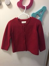 worn once! Red knit cardigan sweater. in Travis AFB, California