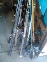FISHING POLES AND TACKLE BOX in 29 Palms, California