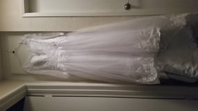 Cathedral train wedding gown and matching veil in Camp Pendleton, California