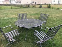 Patio set. Includes 4 cushions in Sugar Grove, Illinois