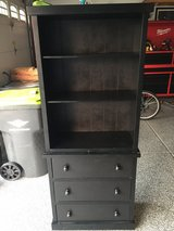 Black bookcase with drawers on bottom in Sandwich, Illinois