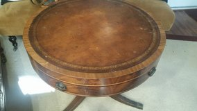 Round table with leather top in Kingwood, Texas