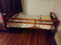 two wooden twin beds in Ottumwa, Iowa