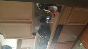 Kitchen cabinets with counter tops and sink in Sandwich, Illinois