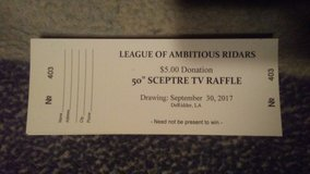 Selling tickets to help are fallen riders family in DeRidder, Louisiana