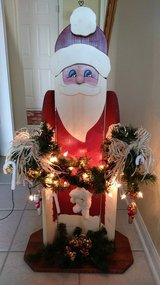 Lighted, wooden standing Santa in New Lenox, Illinois