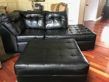 Black chaise couch with matching ottoman in Elgin, Illinois