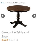 small round dark oak table in Westmont, Illinois