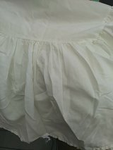 White dust ruffle for a crib or toddler bed in Oswego, Illinois